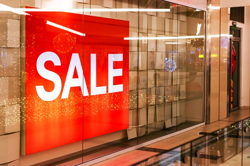 Sale banner in shop window. For end of the season sales deals stock image