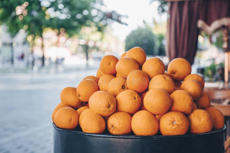 Sale of big fresh natural organic oranges on the city street. Citrus harvesting season. Making of orange fresh juice on royalty free stock photo