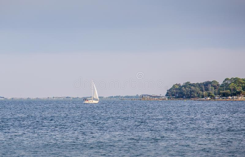 Sale Boat on Choctawhatchee Bay in Ft. Walton Beach, Florida. Sailboat in Choctawhatchee Bay in Ft. Walton Beach, Florida in the wake of Hurricane Irma. Image stock image