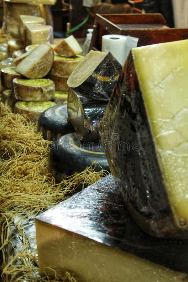 Sale of cheesses at a market stall. Sale of different kind of cheesses at a market stall in Santa Pola, Spain stock photography