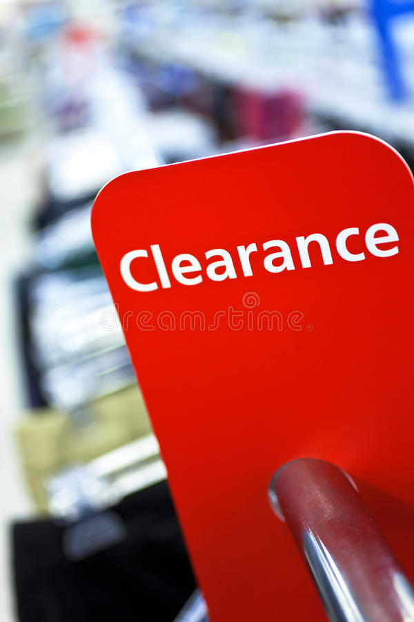 Sale Clearance Sign On Rail in Clothes Shop royalty free stock photo