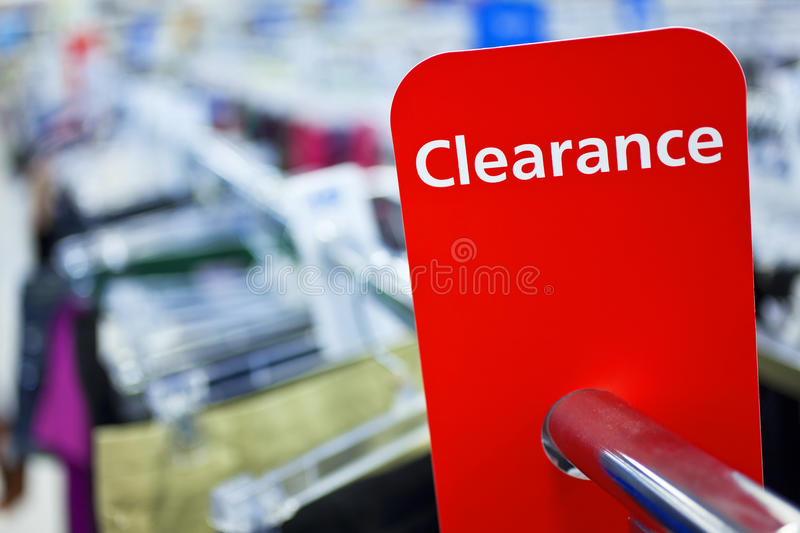 Sale Clearance Sign On Rail in Clothes Shop royalty free stock images