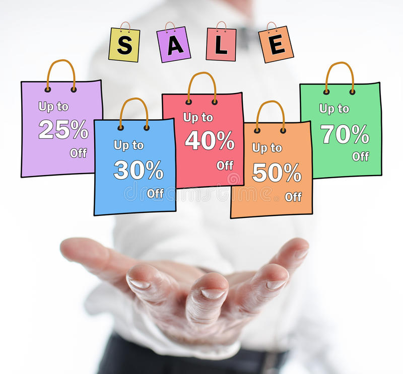 Sale concept levitating above a hand. Of a man royalty free stock image