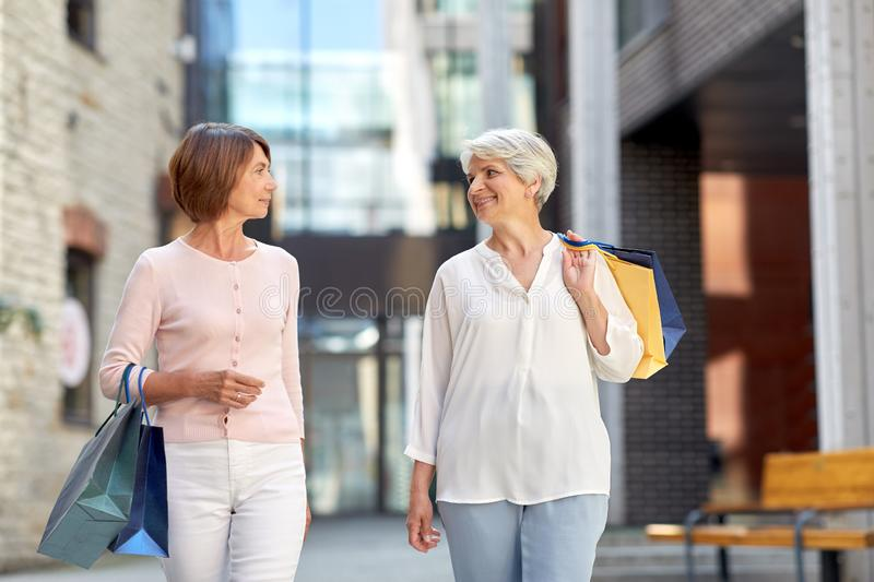 Senior women with shopping bags walking in city royalty free stock images