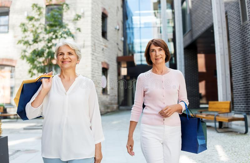 Senior women with shopping bags walking in city royalty free stock image
