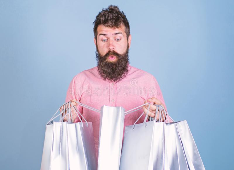 Sale and discount concept. Hipster on shocked face shopping addicted or shopaholic. Guy shopping on sales season with. Discounts. Man with beard and mustache stock photo
