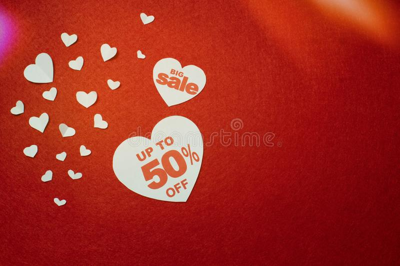 Sale discounts in the heart, minus 50, nice and cute design on the red background royalty free stock images