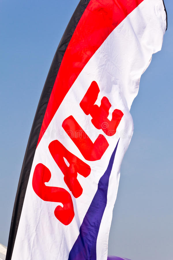 Sale flag flying. Against blue sky royalty free stock image