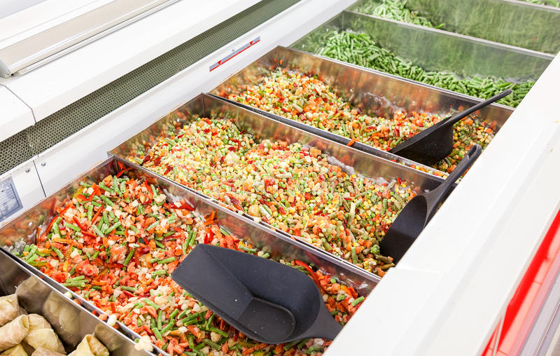 Sale of frozen vegetables in the hypermarket. Network royalty free stock photos