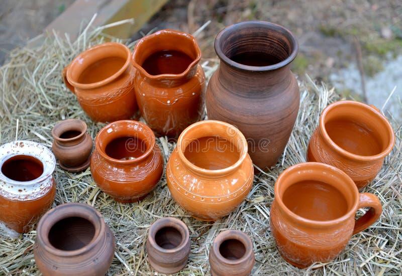 Sale of handmade ceramic ware. Fair of folk art.  stock photos