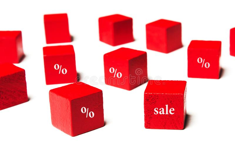 Sale, interest, on red cubes royalty free stock photography