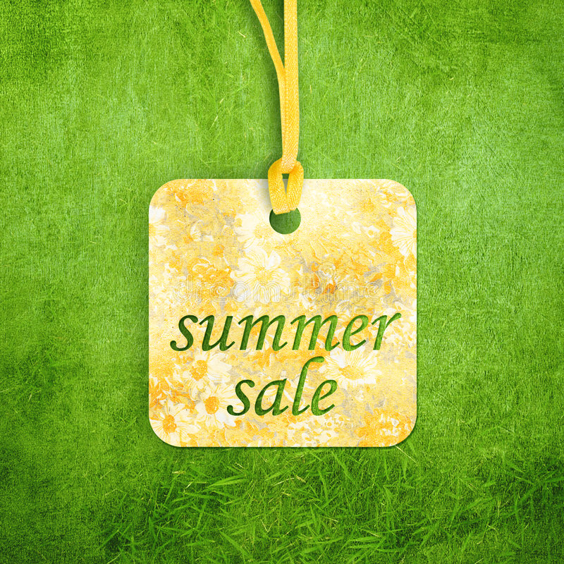 Sale label on grass stock photography