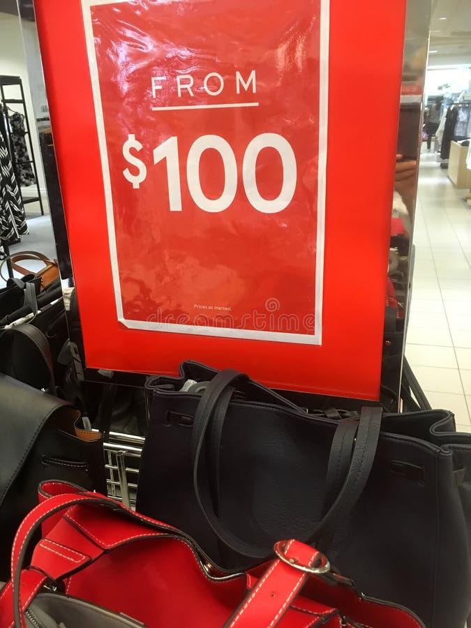 Sale on Ladies handbags stock photos