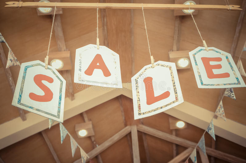 Sale Letters Signs Hanging on The Ceiling. Sale Signs Hanging on The Ceiling of A Store royalty free stock photo