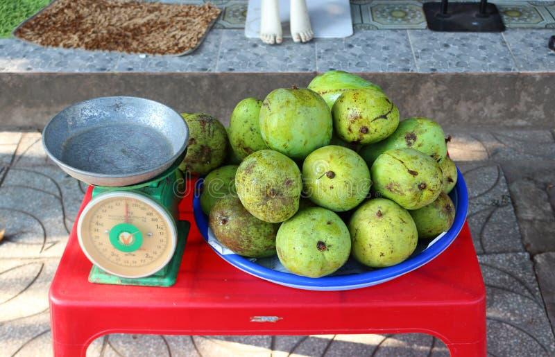 Sale of mangoes on street stock photo