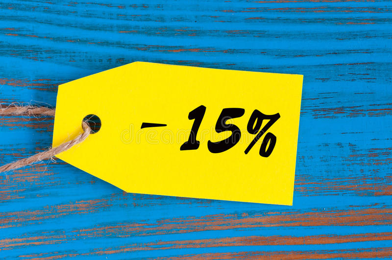 Sale minus 15 percent. Big sales fifteen percents on blue wooden background for flyer, poster, shopping, sign, discount stock image