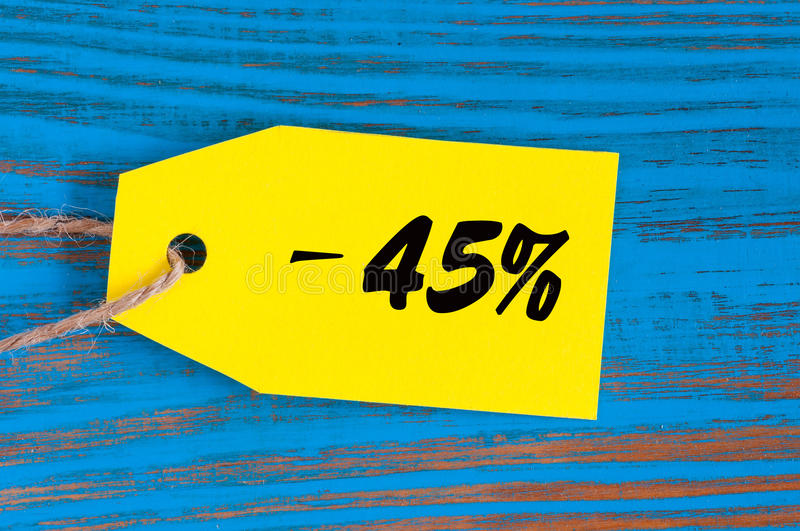 Sale minus 45 percent. Big sales fourty five percents on blue wooden background for flyer, poster, shopping, sign royalty free stock image
