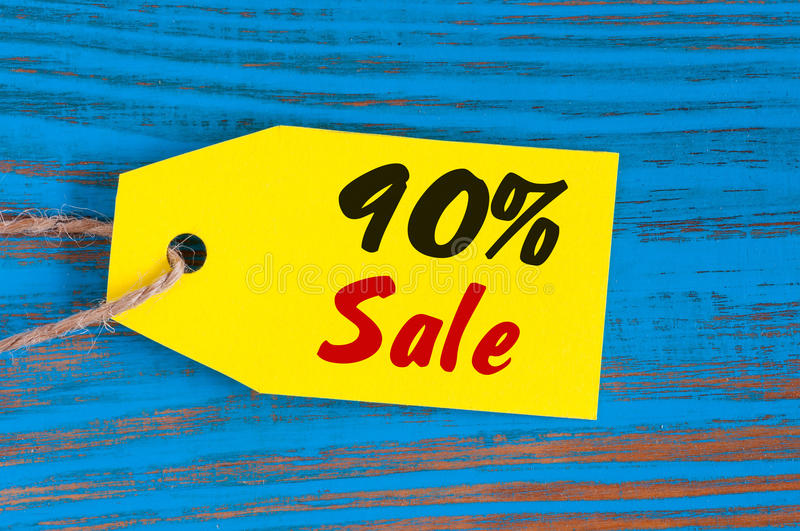 Sale minus 90 percent. Big sales ninety percents on blue wooden background for flyer, poster, shopping, sign, discount stock image