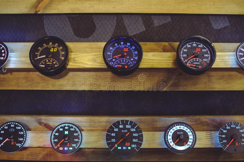 Sale of modern and classic motorcycle and car speedometers, dashboard royalty free stock photos
