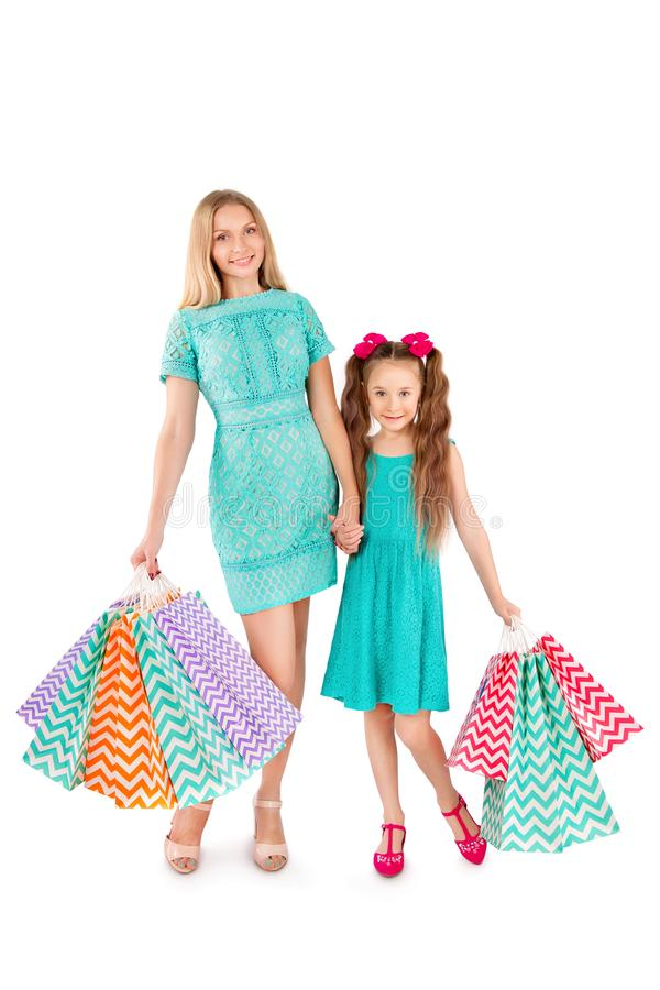 Sale. Mother and daughter with many shopping bags isolated on white background. Family on shopping. royalty free stock photos