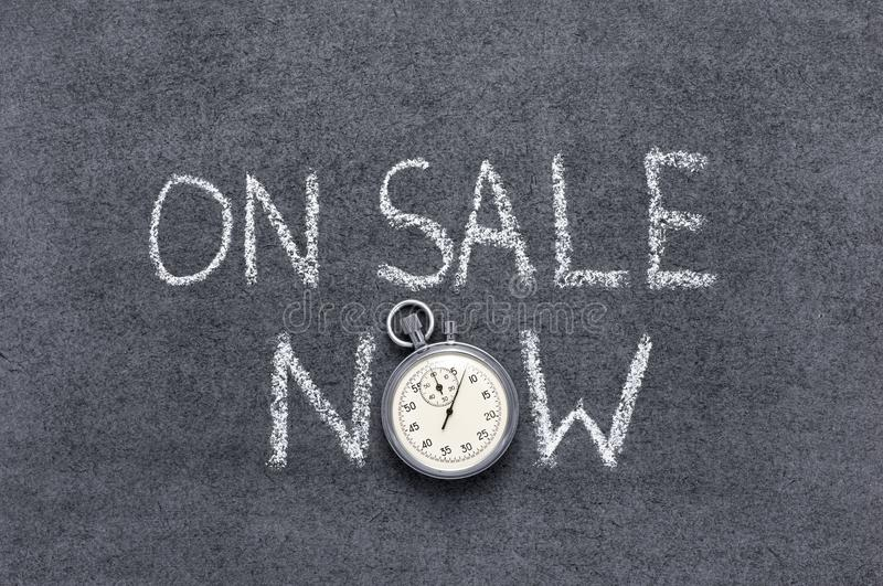 On sale now. Phrase handwritten on chalkboard with vintage precise stopwatch used instead of O royalty free stock image