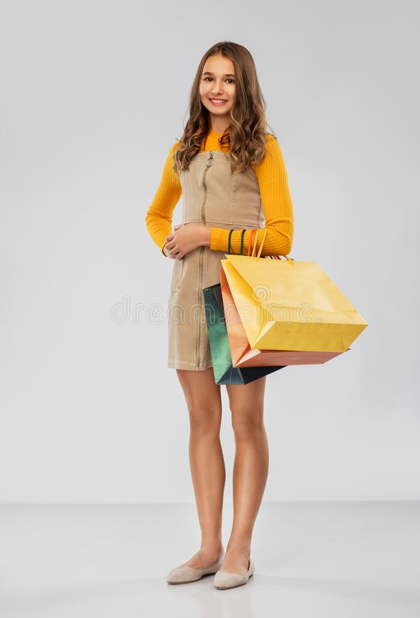 Happy smiling teenage girl with shopping bags stock photos