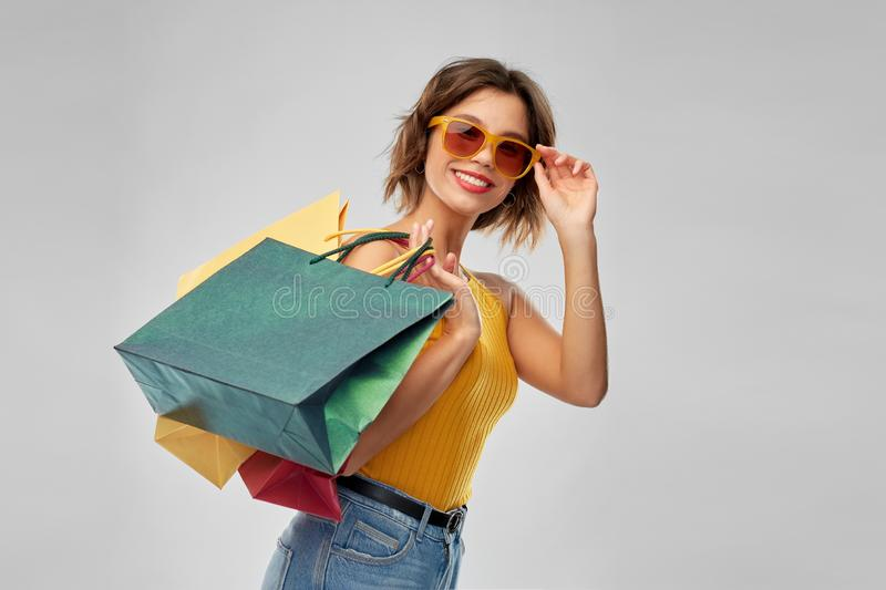 Happy smiling young woman with shopping bags stock photo
