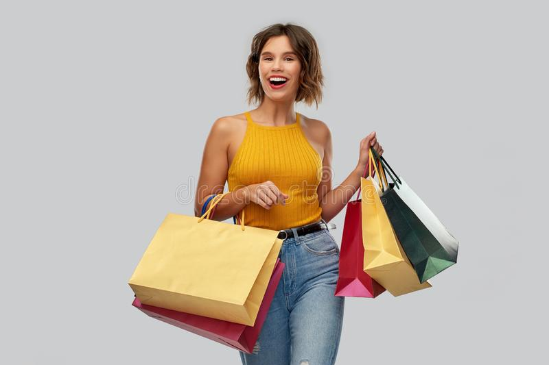 Happy smiling young woman with shopping bags stock images