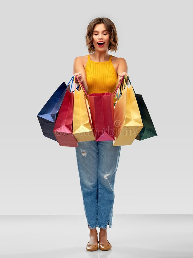 Happy smiling young woman with shopping bags royalty free stock photos
