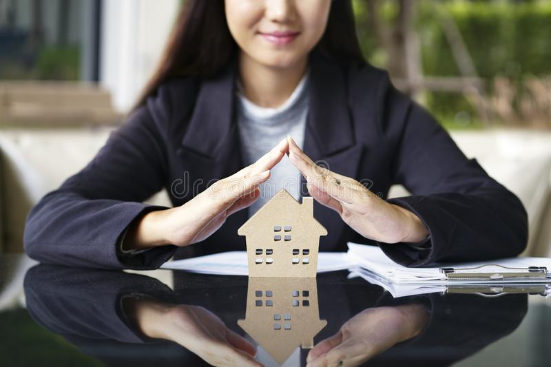 Sale represent real estate agent offer new house, document loan stock photo