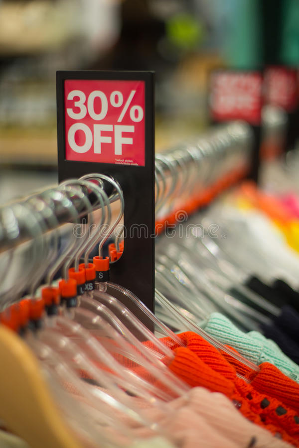 Sale in the retail store. Sale on clothes in the retail store stock images