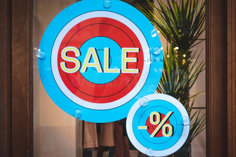 Sale rounded sign in the store, shopping mall, sale, commercial. Clothing store royalty free stock images