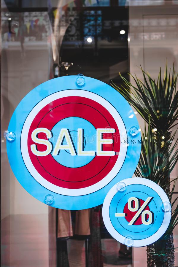 Sale rounded sign in the store, shopping mall, sale, commercial. Clothing store stock photography