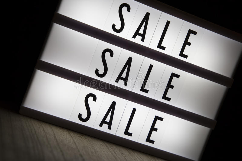 Sale sale sale. `Sale sale sale` text in lightbox royalty free stock photography