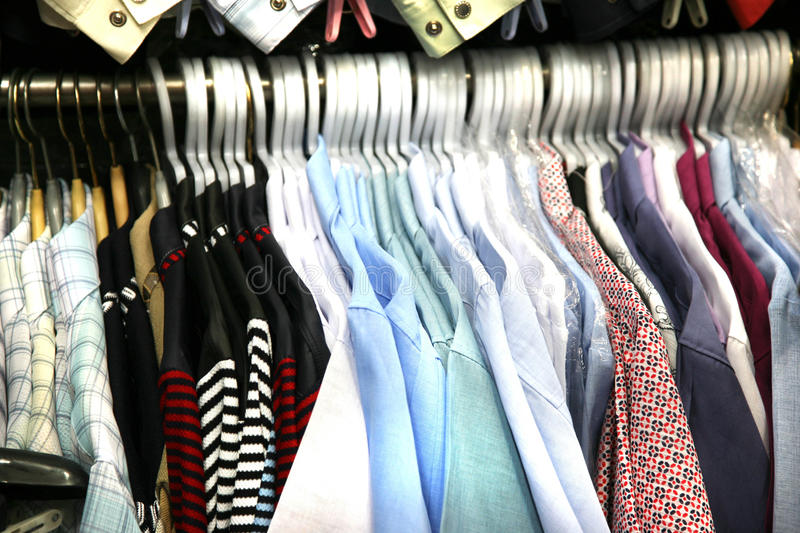 Sale shirts on hangers stock photography