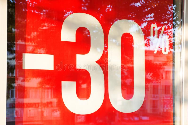 Sale. Shop window with 30 percent discount. Seasonal discounts in the store. A 30% off clearance sale sign royalty free stock photography