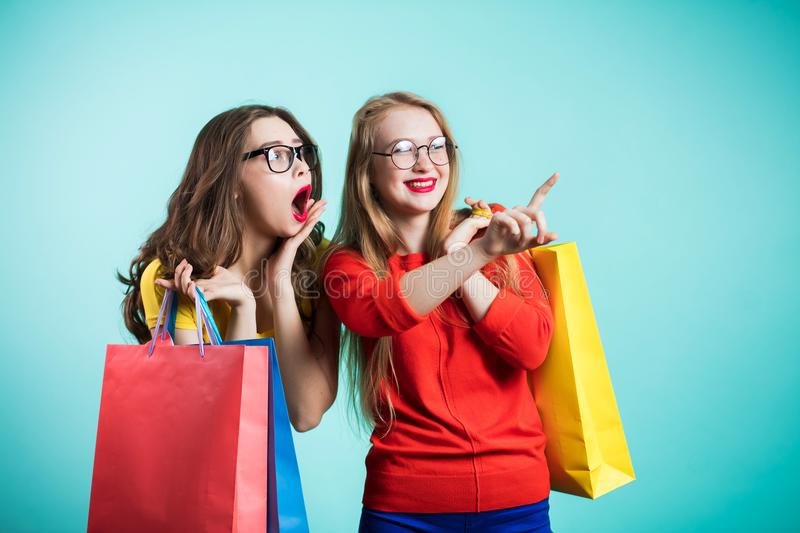 Sale, shopping, emotions concept. Surprised and happy young women royalty free stock image