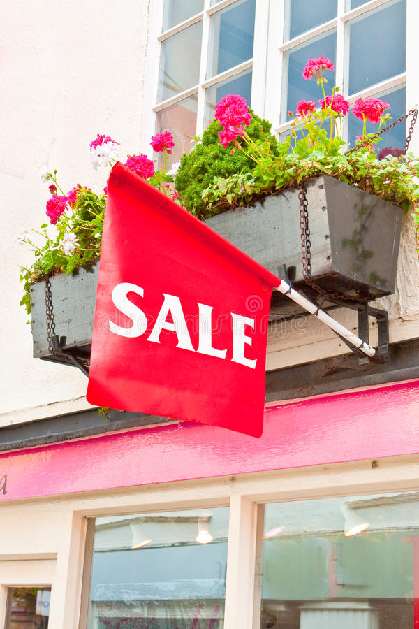 Sale sign. On a small boutique shop in England royalty free stock image