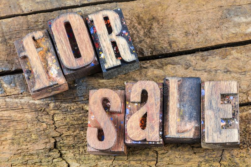 For sale sign letterpress wood. For sale real estate garage yard retail store inventory closeout letterpress type wood rustic motivation background block letters stock photo