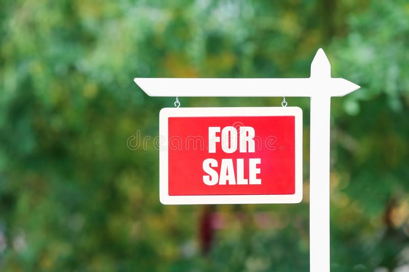 `For sale` sign outdoors. `For sale` sign out doors royalty free stock photo