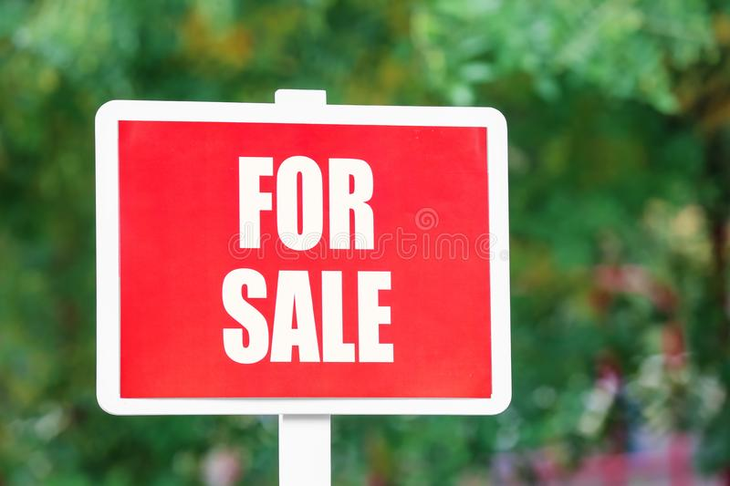 `For sale` sign outdoors. `For sale` sign out doors stock photo