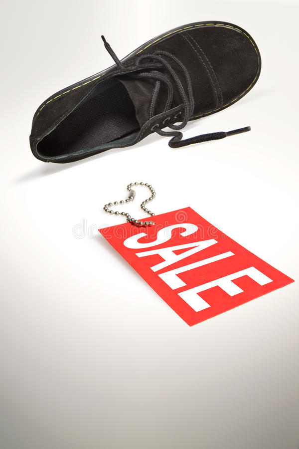 Sale Sign And Shoe Royalty Free Stock Photography