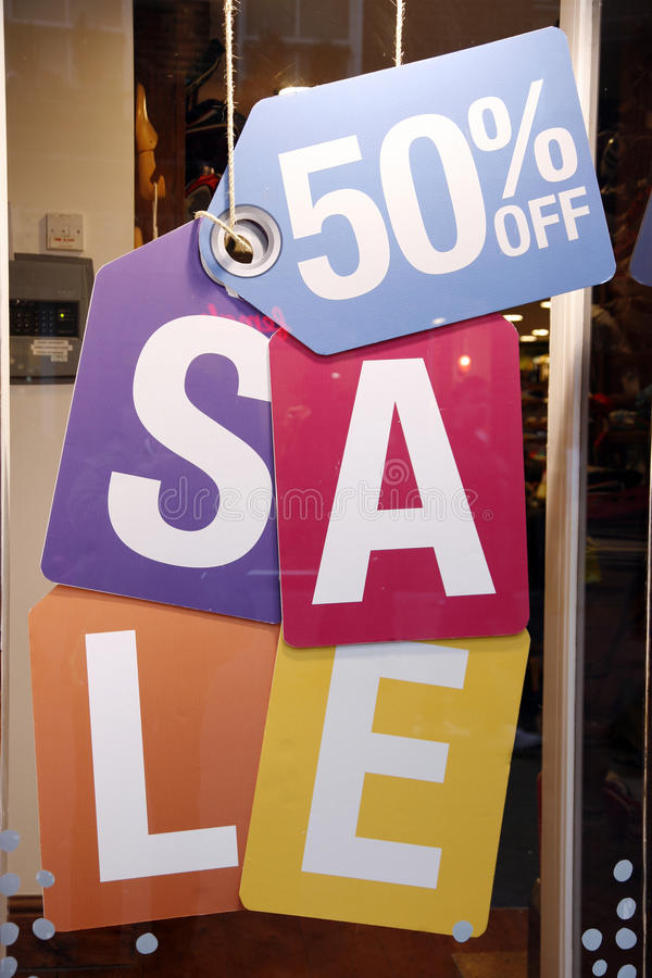 Download Sale signs in shop window stock photo. Image of advertisement - 22693662