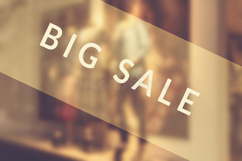 Sale signs in shop window. Selective focus stock photos