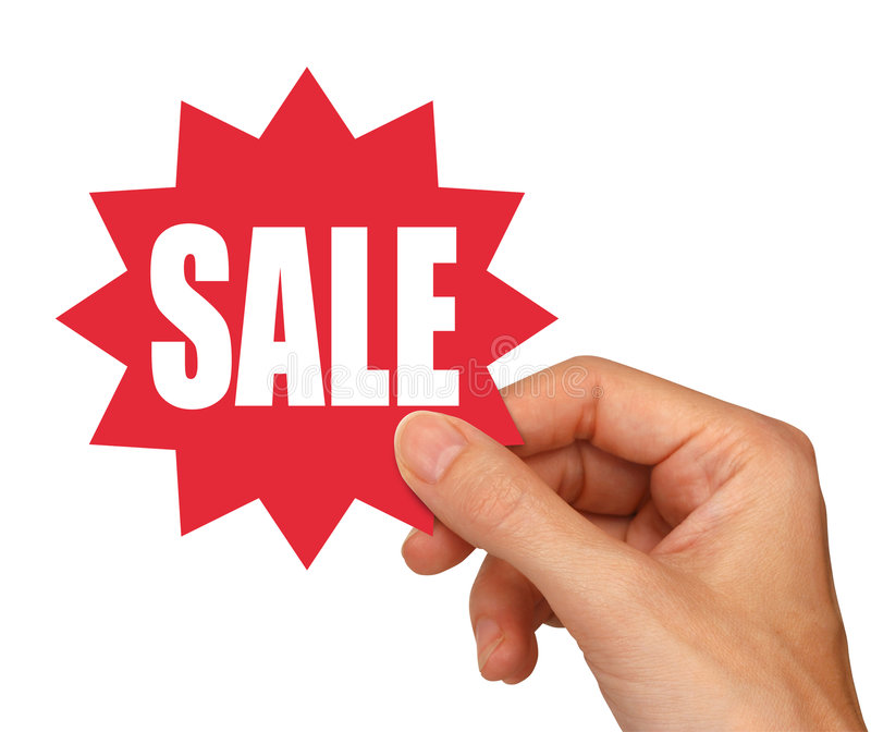 Sale sticker. Hand holding red sale sticker with clipping path royalty free stock photos