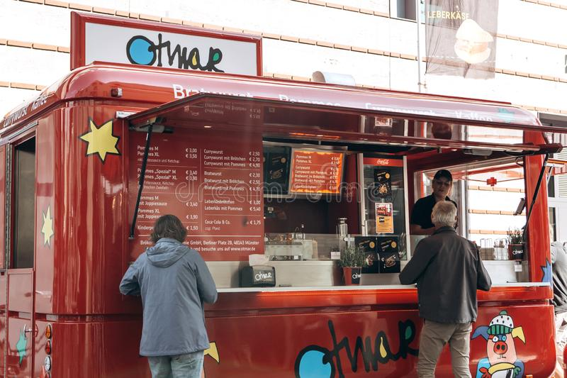 Sale of street food with a truck equipped for trade. Muenster, Germany. Germany, Muenster, October 5 2018: Sale of street food with a truck equipped for trade stock image