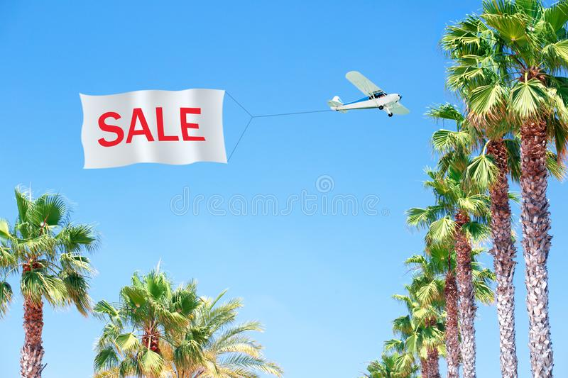 Sale summer banner, poster with tropical leaves, palm and Airplane pulling blank banner. With message-SALE royalty free stock photography