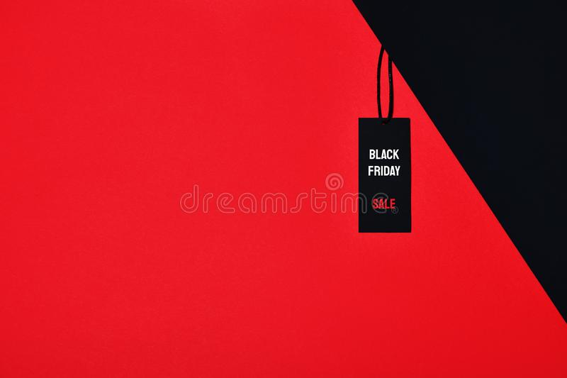 Sale tag with Black Friday and Sale inscription on red and black background. Flat lay vector illustration