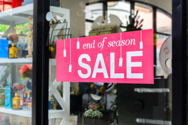 Sale tag on window display stock images