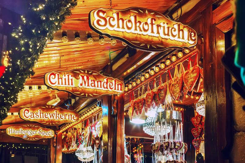 Sale of traditional sweets at German Christmas Market. Hamburg, Germany royalty free stock photography